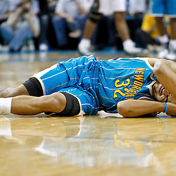 October 27, 2010; New Orleans, LA, USA; New Orleans Hornets point guard Jerryd Bayless (32) grimaces from the floor after colliding with Milwaukee Bucks center Andrew Bogut (not pictured) during the second half at the New Orleans Arena. The Hornets defeated the Bucks 95-91.  Mandatory Credit: Derick E. Hingle