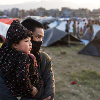 in a makeshift camp<br /> <br />  A local field in the city centre is used by locals for safe overnight sleeping after they lost their homes in Kathmandu, Nepal 27th April 2015 following the devastating earthquake that hit the country on 25 April 2015