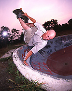 A skateboarder rides an old swimming pool in Reading PA.