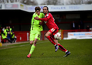 Hartlepool United striker Luke James (33) battles with Crawley Town Defender Charles Dunne (31) during the Sky Bet League 2 match between Crawley Town and Hartlepool United at the Checkatrade.com Stadium, Crawley, England on 19 March 2016. Photo by Jon Bromley.