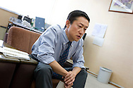 Masami Kawajiri, Deputy Director at the 'Hello Work' employment office, talking in his office, in Toyota city, Japan, on Tuesday 21st April 2009.  In the first 3 months of 2009 the numbers of people seeking work at the 'hello Work' employment office rose 133% compared to the first quarter of 2008. This increase is due to the jobs lost in the industries and companies which serve and supply the Toyota car company and automobile industry, for which Toyota city is famous.