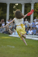Old Westbury, New York, U.S. - June 21, 2014 - Children who are members of the Young Duncan Dancers perform the Scarf Run during the Midsummer Night event, by Lori Belilove & The Isadora Duncan Dance Company, at the Long Island Gold Coast estate of Old Westbury Gardens on the first day of summer, the summer solstice.