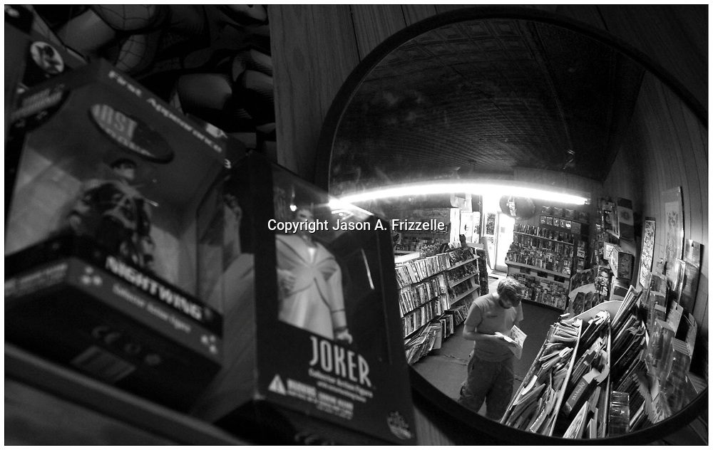 A Customer browses through comic books at N