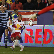 Thierry Henry, New York Red Bulls, gets in his cross while challenged by Aurelien Collin, Sporting Kansas City, during the New York Red Bulls V Sporting Kansas City, Major League Soccer Play Off Match at Red Bull Arena, Harrison, New Jersey. USA. 30th October 2014. Photo Tim Clayton