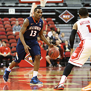 Tracy Abrams #13 of the Illinois Fighting Illini brings the ball up the court during the NIT First Round game at Agganis Arena on March 19, 2014 in Boston, Massachusetts . (Photo by Elan Kawesch)