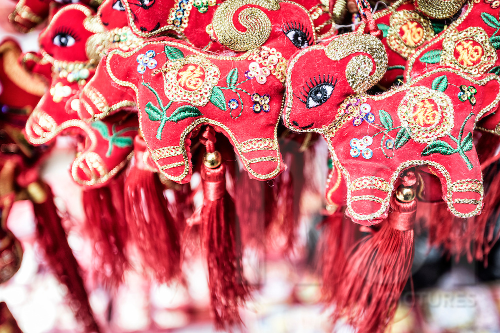 Embroidered goat decorations for Tet sold along Hang Ma Street in Hanoi's Old Quarter, VIetnam, Southeast Asia