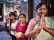 "22 OCTOBER 2015 - YANGON, MYANMAR: Hindus line up at Sri Kali temple in Yangon to greet the goddess Durga on the last day of Navratri. Navratri, literally ""nine nights"" is a Hindu festival devoted to the Goddess Durga. Navratri festival combines ritualistic puja (prayer) and fasting. Navratri in India follows the lunar calendar and is celebrated in September/October as Sharad Navratri. It's widely celebrated in countries in Southeast Asia that have large Hindu communities, including Myanmar (Burma). Many of Myanmar's Hindus are descendants of Indian civil servants and laborers who came to Myanmar when it was the British colony of Burma.    PHOTO BY JACK KURTZ"