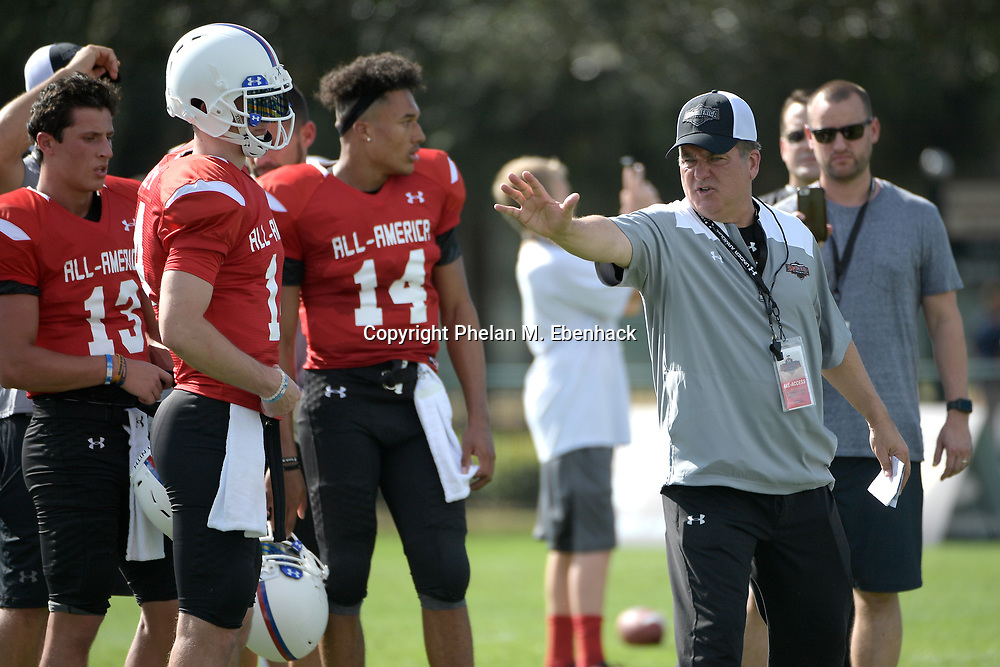 Team Highlight head coach Steve Mariucci, right, works with quarterbacks Tommy DeVito (13), Ryan Kelley, second from left, and Kellen Mond (14) during a practice for the Under Armour All-America football game in Lake Buena Vista, Fla., Wednesday, Dec. 28, 2016. (Photo by Phelan M. Ebenhack)