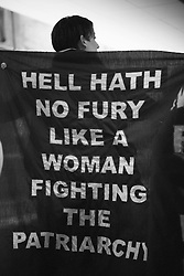 "April wore a cape reading ""HELL HATH NO FURY LIKE A WOMAN FIGHTING THE PATRIARCHY"" on a packed train platform in the metro station after the Women's March on Washington, D.C."