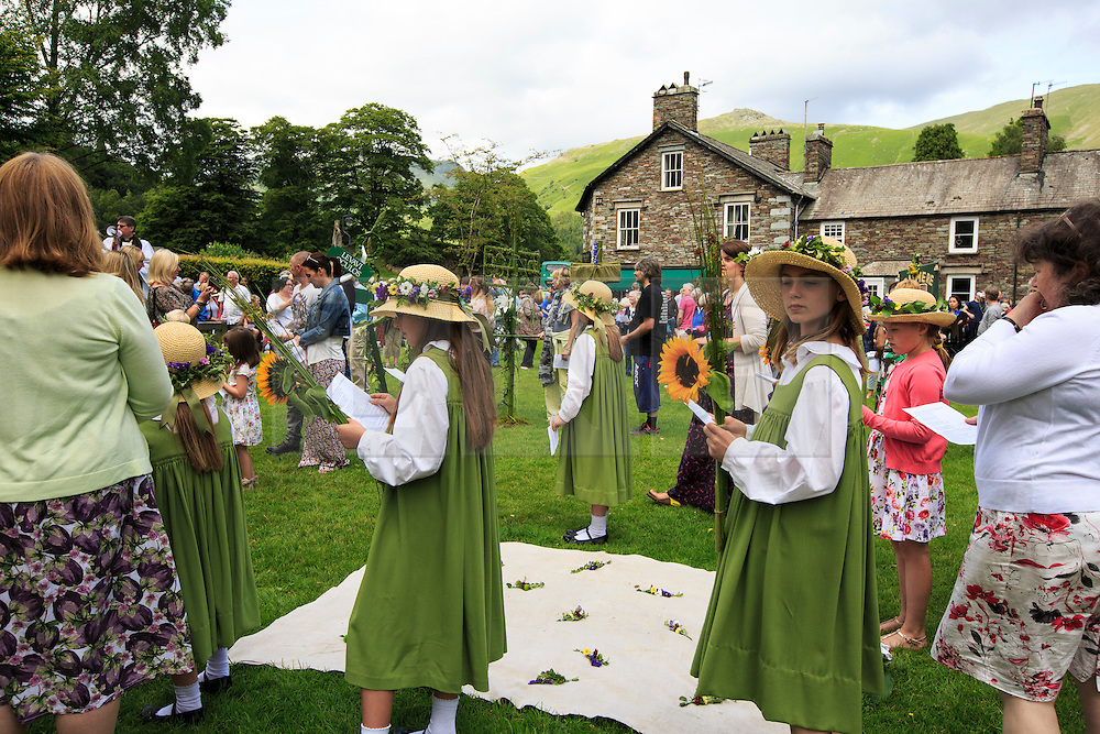 &copy; Licensed to London News Pictures. 11/07/2015. Grasmere, UK. Residents of Grasmere take part in the . Rushbearing festival. Rushbearing is an old English ecclesiastical festival in which rushes are collected and carried to be strewn on the floor of the parish church. <br />