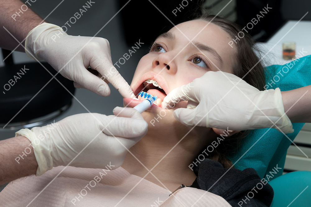 Dental care concept, girl by her dentist to revise the dental appliance
