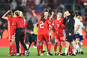 The Wales team celebrate at full time after holding England to a 0-0 draw during the FIFA Women's World Cup UEFA Qualifier match between England Ladies and Wales Women at the St Mary's Stadium, Southampton, England on 6 April 2018. Picture by Graham Hunt.