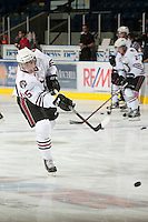 KELOWNA, CANADA - NOVEMBER 9:  Jesse Miller #15 of the Red Deer Rebels warms up on the ice at the Kelowna Rockets on November 9, 2012 at Prospera Place in Kelowna, British Columbia, Canada (Photo by Marissa Baecker/Shoot the Breeze) *** Local Caption ***