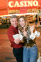 Mid-adult couple in front of casino building, portrait