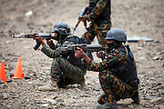 Members of the Yemen Special Forces Counter-Terrorism squad fire at stationary targets with automatic weapons during live-fire drills at a training range on the outskirts of Sana'a, Yemen April 14, 2010. Yemen continues efforts to improve the quality of its' armed forces as it faces a Houthi rebel movement in the North, a  separatist movement in its Southern territory, and Al Qaeda terrorist activity.