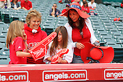 ANAHEIM, CA - MAY 08:  Two mothers and their young daughters have fun with foam fingers at the Mother's Day game between the Cleveland Indians and the Los Angeles Angels of Anaheim on Sunday, May 8, 2011 at Angel Stadium in Anaheim, California. The Angels won the game 6-5. (Photo by Paul Spinelli/MLB Photos via Getty Images)