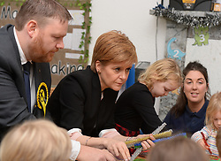 SNP leader Nicola Sturgeon joined children and the SNP candidate for Midlothian Owen Thompson at the Happy days Nursery in Hardengreen, Midlothian to make Christmas cards.<br /> <br /> © Dave Johnston / EEm