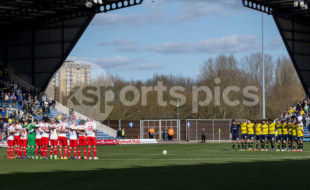 Both teams respect a minutes silence for the Brussel's bombing during the Sky Bet League 2 match between Oxford United and Stevenage at the Kassam Stadium, Oxford, England on the 25th March 2016. Photo by Liam McAvoy.