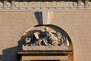 View from below of the pediment and carved inscription on the neo-classical amphitheatre built in 1787 and 1788 by Edme Verniquet, located in the Jardin des Plantes, Paris, 5th arrondissement, France. Founded in 1626 by Guy de La Brosse, Louis XIII's physician, the Jardin des Plantes, originally known as the Jardin du Roi, opened to the public in 1640. It became the Museum National d'Histoire Naturelle in 1793 during the French Revolution. Picture by Manuel Cohen