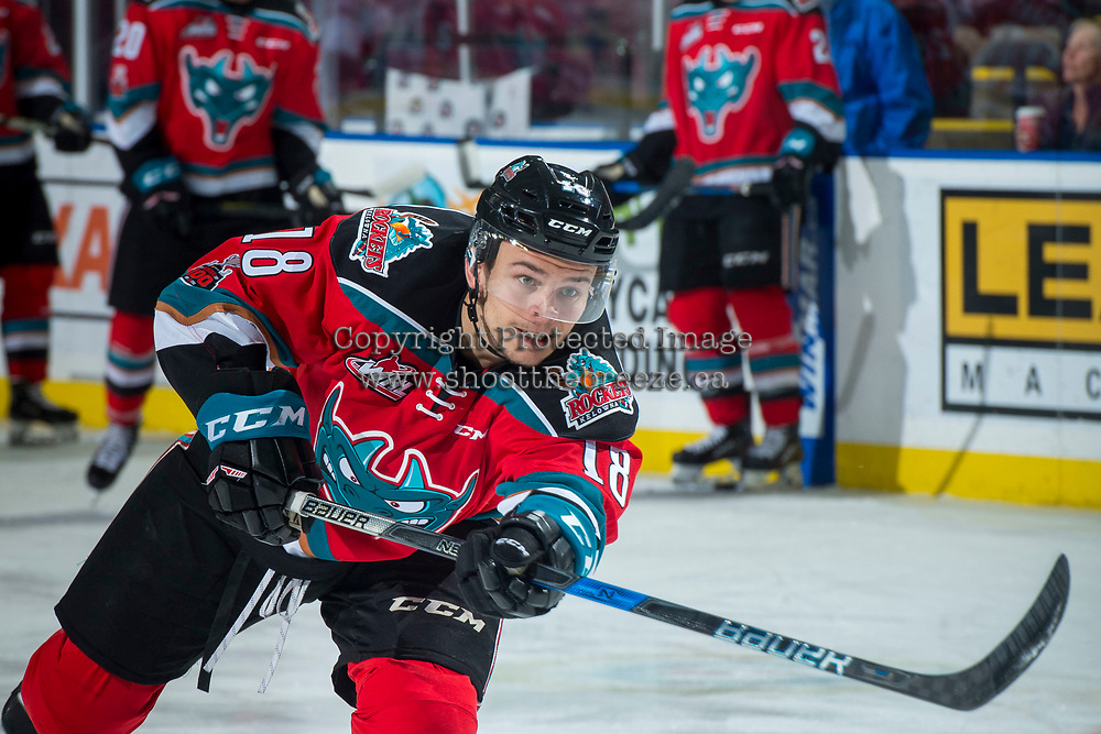 KELOWNA, CANADA - NOVEMBER 29: Carsen Twarynski #18 of the Kelowna Rockets takes a shot during warm up against the Prince George Cougars on November 29, 2017 at Prospera Place in Kelowna, British Columbia, Canada.  (Photo by Marissa Baecker/Shoot the Breeze)  *** Local Caption ***