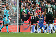 AFC Wimbledon defender Paul Robinson (6) holds his head in his hands after hitting the psot during the Sky Bet League 2 play off final match between AFC Wimbledon and Plymouth Argyle at Wembley Stadium, London, England on 30 May 2016.