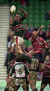 © Peter Spurrier/ Intersport Images.Photo Peter Spurrier.01/03/2003 Sport - Semi final Powergen Cup Rugby -.Leicester  v Gloucester - Franklin Gardens.Martin Johnson dominates the line collecting a passing the ball the Jamie Hamilton..