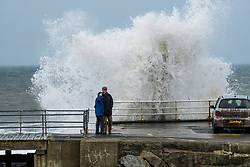 © London News Pictures. 25/12/2017. Aberystwyth, UK.  Strong gale force winds, gusting to over 40mph,  and the high tide combine to whip huge waves crashing into the sea defences on the promenade in Aberystwyth on the west coast of Ceredigion, Wales. Photo credit: Keith Morris/LNP