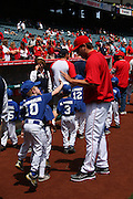 ANAHEIM, CA - APRIL 26:  Pitcher Joe Saunders #51 of the Los Angeles Angels of Anaheim gets a high five from a youngster during Little League Days before the game against the Seattle Mariners at Angel Stadium on Sunday, April 26, 2009 in Anaheim, California.  The Angels shut out the Mariners 8-0.  (Photo by Paul Spinelli/MLB Photos via Getty Images) *** Local Caption *** Joe Saunders