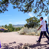 "CEO James Malm leads University of New Mexico-Gallup faculty and staff on a trail jaunt for  ""Walking out on Work""  to support the American Heart Association's National Walking Day in Gallup April 4."