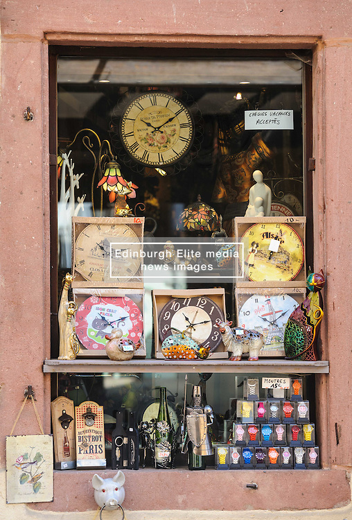 Window of a shop selling clocks and other tourist items in the 16th Century village of Riquewihr, Alsace, France<br /> <br /> (c) Andrew Wilson | Edinburgh Elite media