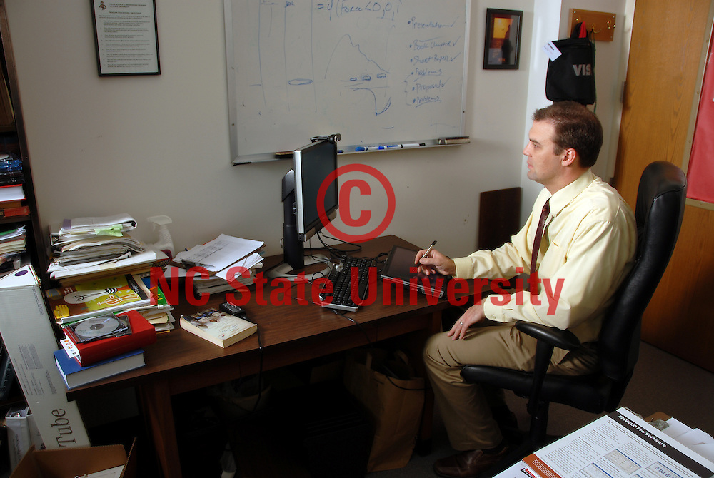 CNR professor tapes a forestry class via computer in his office. PHOTO BY ROGER WINSTEAD
