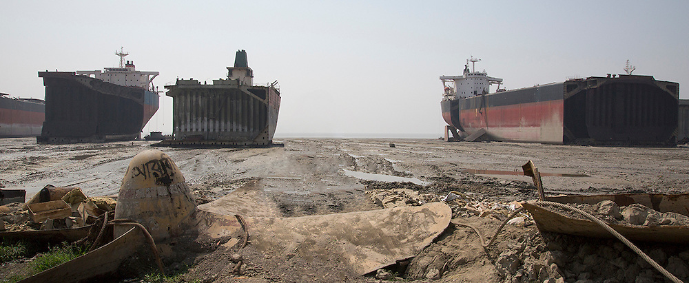 Ship breaking, and rebuilding, yards in Bangladesh: in Dhaka, long river Buriganga irremediably contaminated by fuel waste left in the tanks and by heavy metals, big sections are removed by explosives and cut with blow torches. A huge helix, half-buried in front of me, makes me realize the proportions of these giants of the sea and the backbreaking work of dismantling made barehanded by thousands of workers. <br /> They have been designed and built for resisting to the waves of the ocean in a storm, for lasting decades and carry huge cargoes around the world: but what happens when their end comes, when the last trip begins?<br /> Why a lot of naval companies bring here their disused vessel for dying?<br /> What are the tasks carried out in these areas?<br /> How is the life of those Bengali men who, while to work and survive, are willing to make one of the most dangerous jobs in the world?