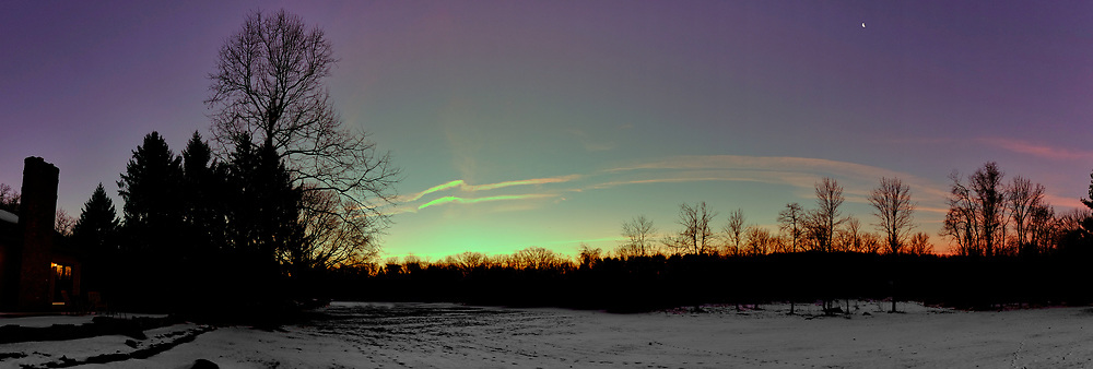Colorful Contrails at Dawn. Backyard Winter Nature in New Jersey. In camera panorama (jpg) taken with a Fuji X-T1 camera and 16 mm f/1.4 lens (ISO 200, 16 mm, f/3.6, 1/125 sec).