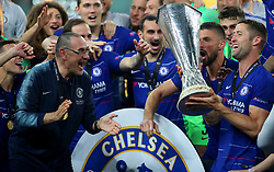 Chelsea's Gary Cahill and Chelsea manager Maurizio Sarri celebrate with the trophy after the UEFA Europa League final at The Olympic Stadium, Baku, Azerbaijan. PRESS ASSOCIATION Photo. Picture date: Wednesday May 29, 2019. See PA SOCCER Europa. Photo credit should read: Bradley Collyer/PA Wire