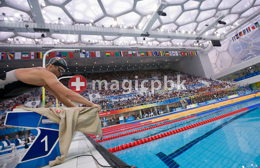 Dominik MEICHTRY of Switzerland dries the starting block with his sweater before competing in the Men's 200m Freestyle Final held at the National Aquatics Center (Water Cube) at the Beijing 2008 Olympic Games in Beijing, China, Tuesday, Aug. 12, 2008. (Photo by Patrick B. Kraemer / MAGICPBK)