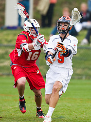 Virginia Cavaliers A Danny Glading (9) passes around Maryland Terrapins SSM Dean Hart (16).  The #9 ranked Maryland Terrapins fell to the #1 ranked Virginia Cavaliers 10 in 7 overtimes in Men's NCAA Lacrosse at Klockner Stadium on the Grounds of the University of Virginia in Charlottesville, VA on March 28, 2009.