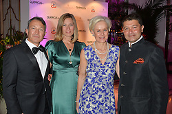 Left to right, DAVID & ALEXIS MANDIYA and VINAYAK & LOUISE BHATTACHARJEE at the QBF Spring Gala in aid of the Red Cross War Memorial Children's Hospital hosted by Heather Kerzner and Jeanette Calliva at Claridge's, Brook Street, London on 12th May 2015.