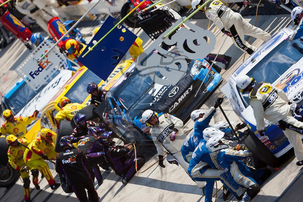 DOVER, DE - JUN 03, 2012:  Denny Hamlin (11) races during the FedEx 400 Benefiting Autism Speaks at the Dover International Speedway in Dover, DE.