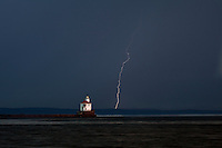 WI00185-00...WISCONSIN - Lightning storm during sunrise at Wisconsin Point Lighthouse on Lake Superior near the town of Superior.