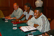 ADDIS ABABA, ETHIOPIA..Sheraton Addis Hotel. German travel expert Paul Friedrich (l.) of Afrika Reisen Exklusiv and high jumper Amewu Mensah (2nd from l.) with the Olympic Winner over 10.000 m, Haile Gebre Selassie (3rd from l.).(Photo by Heimo Aga)