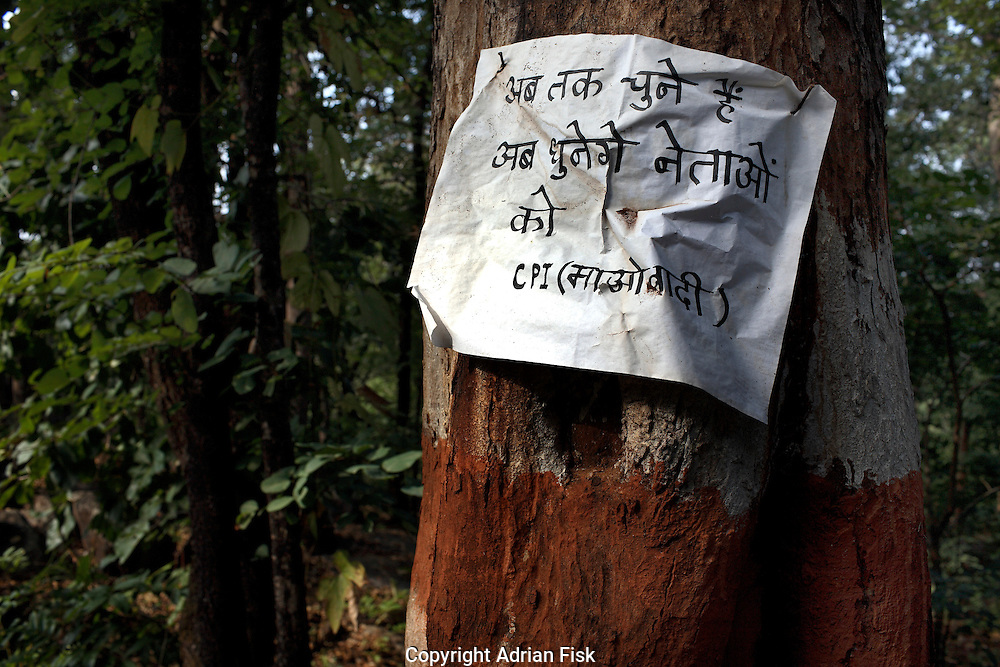 On the road from the state capital Raipur to the southern Chhattisgarh town of Dantewada a Naxalite poster warns 'Til now we elected the leaders, now we will beat them with violence'.