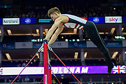 Sam Oldham of Great Britain on the horizontal bar during the The Superstars of Gymnastics event at the O2 Arena, London, United Kingdom on 23 March 2019.