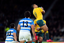 Will Genia of Australia claims the ball in the air - Mandatory byline: Patrick Khachfe/JMP - 07966 386802 - 08/10/2016 - RUGBY UNION - Twickenham Stadium - London, England - Argentina v Australia - The Rugby Championship.