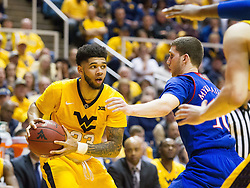 Jan 24, 2017; Morgantown, WV, USA; West Virginia Mountaineers forward Esa Ahmad (23) looks to pass the ball during the second half against the Kansas Jayhawks at WVU Coliseum. Mandatory Credit: Ben Queen-USA TODAY Sports