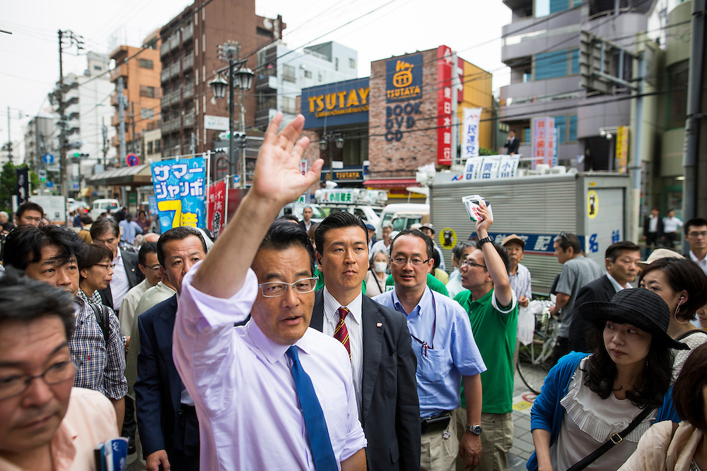 TOKYO, JAPAN - JULY 6 : Katsuya Okada President of Democratic Party of Japan (DPJ) waves his hands to his supporters during the Upper House election campaign outside of Machiya Station, Tokyo prefecture, Japan, on July 6, 2016. Japan's upper house election will be held on this coming Sunday, July 10, 2016. (Photo by Richard Atrero de Guzman/NUR Photo)