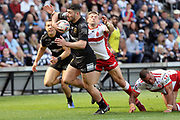 Hull FC second row forward Mark Minichiello (12) bursts through during the Betfred Super League match between Hull FC and Hull Kingston Rovers at Kingston Communications Stadium, Hull, United Kingdom on 19 April 2019.