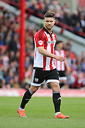 Brentford striker, Scott Hogan (9) on his own during the Sky Bet Championship match between Brentford and Fulham at Griffin Park, London, England on 30 April 2016. Photo by Matthew Redman.