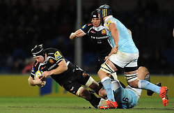 Exeter Chiefs Thomas Waldrom is tackled by Newcastle Falcons Richard Mayhew - Photo mandatory by-line: Harry Trump/JMP - Mobile: 07966 386802 - 14/02/15 - SPORT - Rugby - Aviva Premiership - Sandy Park, Exeter, England - Exeter Chiefs v Newcastle Falcons