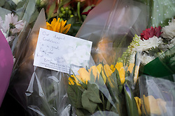 © Licensed to London News Pictures . FILE PICTURE DATED 15/07/2013 . Oldham Street , Manchester , UK .  Flowers and tributes left at the scene on Oldham Street from Blue Watch Blackley following a fire at Paul 's Hair World on 13th July which claimed the life of fireman Stephen Hunt . Photo credit : Joel Goodman/LNP