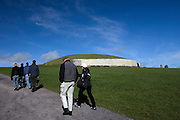 Tourists visiting Newgrange passage grave, County Meath, Ireland.